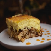 Pasticcio vs Moussaka 🤜🏻🤛🏻  Perhaps the biggest juggernauts in Yiayia's recipe book. We'll break ours down for you below...  Pasticcio- #2 macaroni, black angus beef, béchamel w. saffron & kefalotiri  Moussaka- same beef & béchamel but swap out the macaroni for grilled eggplant, zucchini & potatoes   Silver lining? There's no wrong choice. Both are bound to leave you satisfied 💯